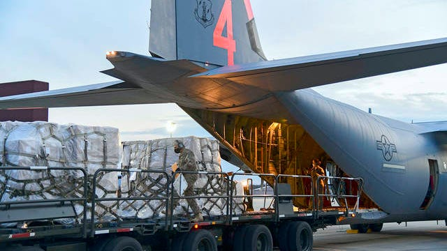 In this Tuesday photo provided by the U.S. Air National Guard, airmen from the 146th Airlift Wing of the California Air National Guard in Oxnard, Calif., deliver 200 ventilators to the New York Air National Guard's 105th Airlift wing at Stewart Air National Guard Base, adjacent to Newburgh, N.Y.