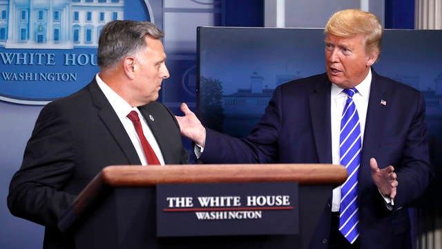 President Donald Trump talks with Bill Bryan, head of science and technology at the Department of Homeland Security, as he speaks about the coronavirus in the James Brady Press Briefing Room of the White House, Thursday, in Washington.