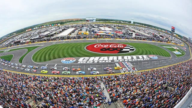 In this May 27, 2018 file photo, the field takes the green flag to start the NASCAR Cup Series auto race at Charlotte Motor Speedway in Concord, N.C. The governor of North Carolina says NASCAR can go forward with the Coca-Cola 600 at Charlotte Motor Speedway at the end of May so long as health conditions do not deteriorate in the state. Gov. Roy Cooper said Tuesday he and state public health officials have had discussions with NASCAR and the speedway regarding its safety protocols for staging a race without spectators. Cooper said the state offered input on NASCAR's plan, but he believes the race can go forward on Memorial Day weekend for the 60th consecutive year.
