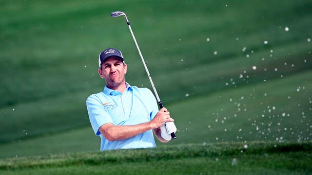 In this March 5, 2020, file photo, Brendon Todd watches his shot after hitting from a bunker onto the ninth green during the first round of the Arnold Palmer Invitational golf tournament in Orlando, Fla. Todd says he is willing to take risks from the new coronavirus when the PGA Tour resumes its season.