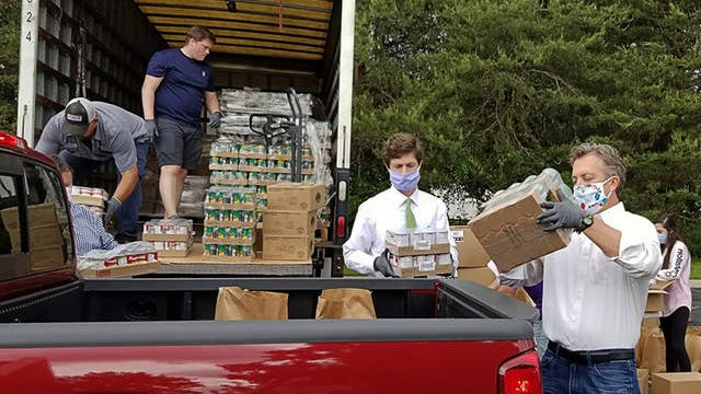 Columbia Mayor Chaz Molder, left, and Maury County Mayor Andy Ogles, right, load supplies into a truck for South Central Human Resource Agency on Tuesday May 5, 2020.