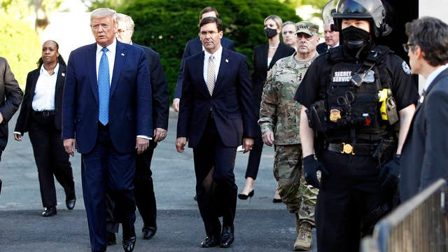 In this June 1 file photo, President Donald Trump departs the White House to visit outside St. John's Church in Washington.