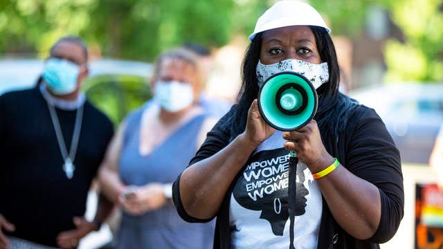 In this June 19 photo Jeannine Lee Lake, Democratic candidate for Indiana's 6th congressional district, speaks to the crowd gathered for Juneteenth day event in Columbus, Ind. The reenergized movement against racial inequality and police brutality following the killing of George Floyd in Minneapolis has amplified the voices of Black candidates across the country. Among them is Lake, who is challenging Rep. Greg Pence, the vice president's brother, in a deeply conservative Indiana district.