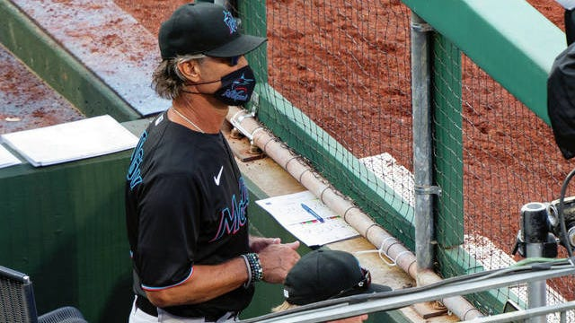 Miami Marlins' manager Don Mattingly looks out from the dugout during the eighth inning of a baseball game against the Philadelphia Phillies last weekend in Philadelphia.