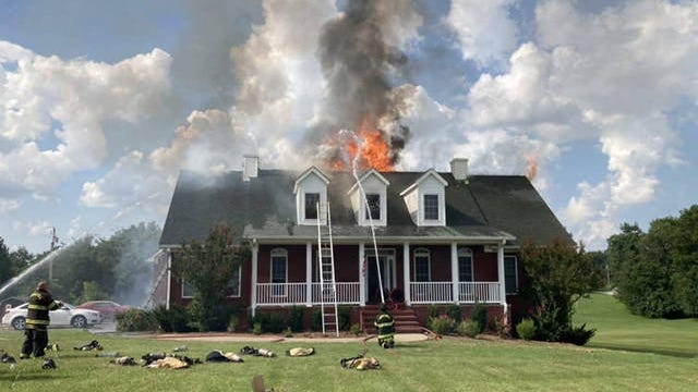 Firefighters with Maury County Fire Department work to extinguish a burning home on Ollie Chunn Road on Saturday, July 18, 2020.