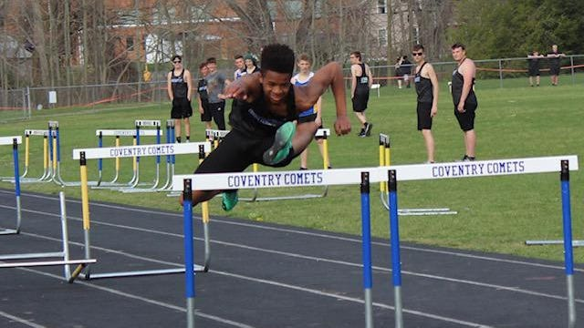 Coventry senior Damian Jackson clears a hurdle during a meet last season at Coventry High School. Jackson placed third in the 110-meter hurdles in last season's Division II state meet.