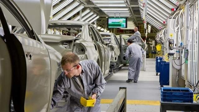 Volkswagen Passat sedans are in the paint shop at the German automaker's plant in Chattanooga, Tenn. in July 2012.
