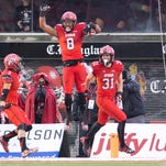 Utah's Kaelin Clay (8) celebrates after returning a punt for a touchdown in a Nov. 22 game against Arizona.