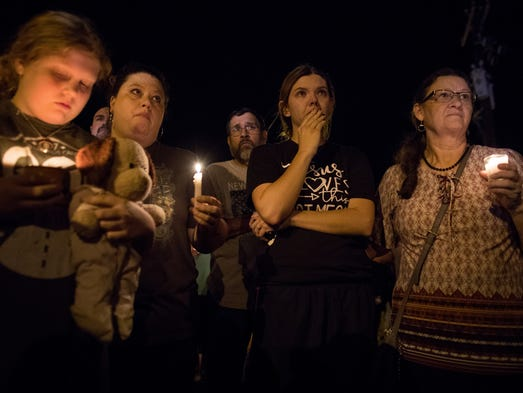 Community members attend a vigil for the victims of