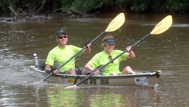 A couple paddle their way down Bayou Teche.