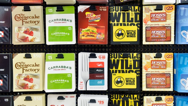 Restaurant gift cards are pictured at Weis Markets in West Manchester Township. Several national restaurant chains with locations in York County, including Ruby Tuesday and Olive Garden Italian Kitchen, are giving a free bonus gift card with the purchase of a gift card. In addition, some local, independently-owned restaurants have begun offering discounts of up to half-off on gift cards.