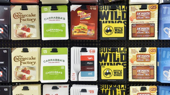 This Gannett file photo shows restaurant gift cards at a grocery store. Many restaurants offer gift card freebies at this time of the year.