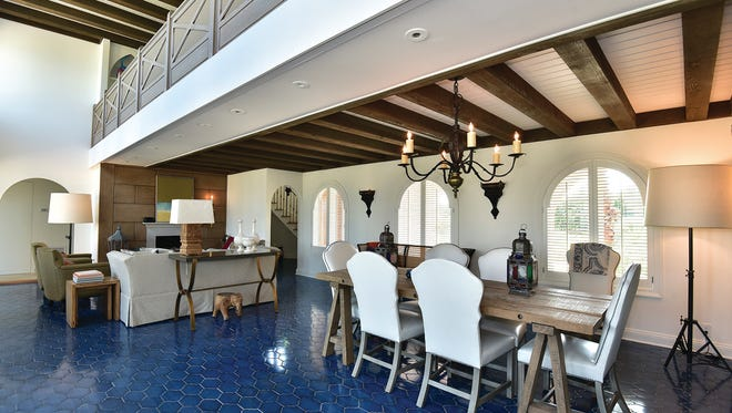 111 Sabine Drive, the combination living and dining area is filled with natural light.