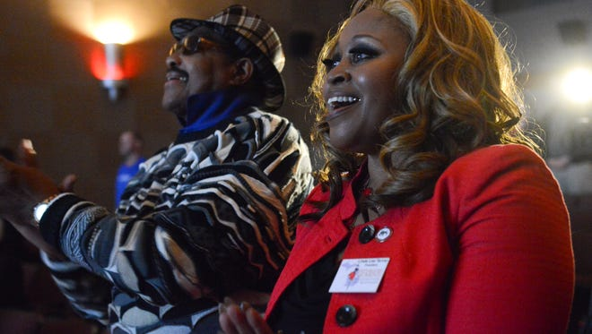 Linda Lee Tarver celebrates on Friday, Jan. 20, 2017 during an inauguration viewing party at the Sun Theatre in Williamston, Mich. Donald Trump was sworn in as the 45th president of the United States.