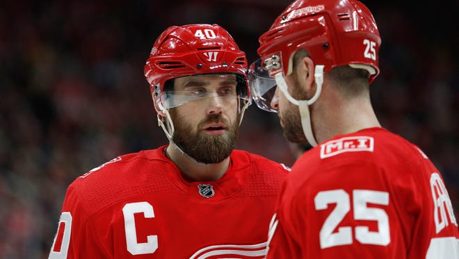 Red Wings center Henrik Zetterberg (40) talks with defenseman Mike Green (25) during the first period on Sunday, Dec. 31, 2017, at Little Caesars Arena.
