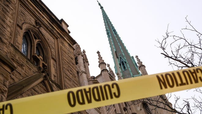 A piece of caution tape along the sidewalk is seen in the foreground of the steeple from Fort Street Presbyterian Church on Fort St. in downtown Detroit on Wednesday January 24, 2018 in Detroit.