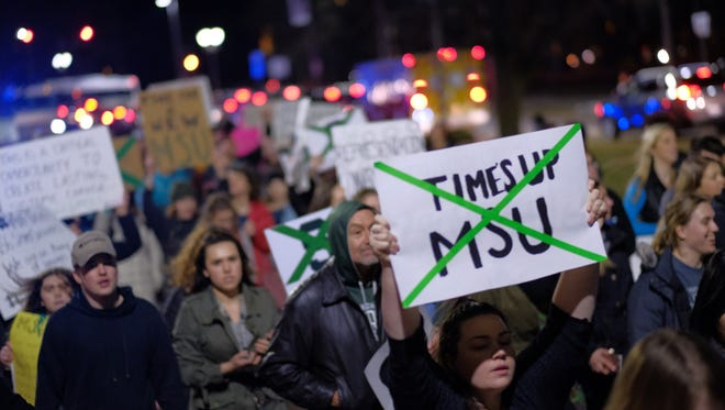 People March along Grand River in East Lansing in  January on the Michigan State University campus in East Lansing while speaking out against sexual assault following the Larry Nassar case.