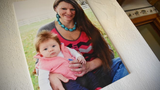 A photo of Lacey Kuschel and her daughter Aspen is on display at the family's ranch Thursday, April 19, near Sebeka.