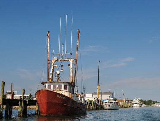 A commercial fishing boat is docked near Harbor Road