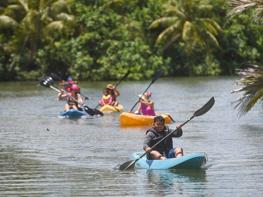 Festivalgoers experience kayak rides on the Talofofo River during the Valley of the Latte River Festival in Talofofo on April 2, 2017.