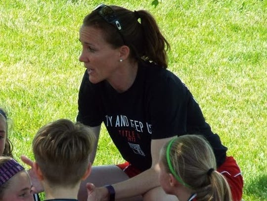 Madison 56ers coach, Molly Duffy, talking to her team.