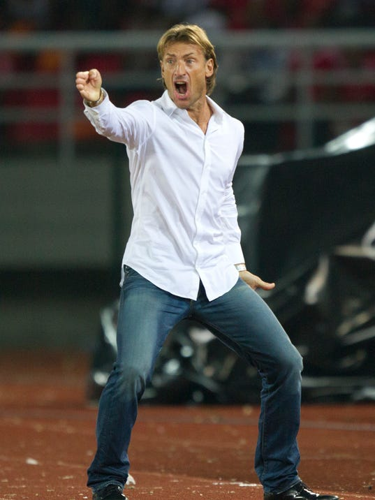 FILE - In this file photo taken Saturday, Jan. 21, 2012, Zambia's head coach Herve Renard of France screams during the African Cup of Nations Group A soccer match against Senegal in Bata, Equatorial Guinea. Renard was appointed Ivory Coast coach on a four-year deal on Thursday, July 31, 2014, succeeding compatriot Sabri Lamouchi who failed to lead the talent-filled West African team past the group stage at the World Cup in Brazil. (AP Photo/Ariel Schalit, File)