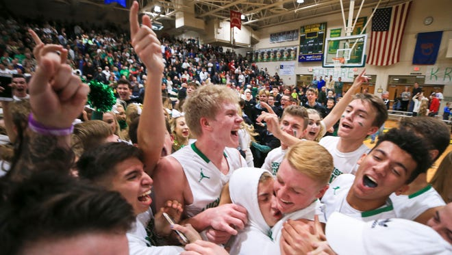 Floyd Central students and the basketball team jammed the court to celebrate after the Highlanders' 49-47 win over New Albany in overtime Friday evening. Senior Luke Gohmann led the Highlanders with 17 points. It was the Highlanders' first win over New Albany in boys basketball since 2003.