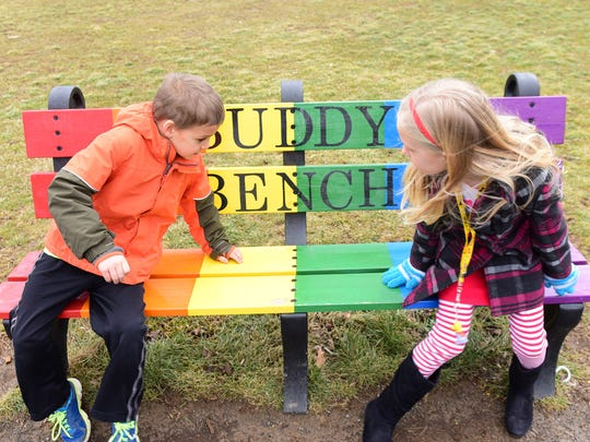 Cooper Noblit, left,  and Camryn Guthrie share the Buddy Bench Thursday, Feb. 25, 2016 at Greencastle-Antrim Primary School. The Buddy Bench is part of G-A's anti bullying program to teach students to be buddies, not bullies.