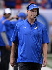 Air Force head coach Troy Calhoun walks the sideline during the first half of an NCAA college football game against Georgia State in Atlanta, Saturday, Sept. 13, 2014. Air Force won 48-38. (AP Photo/Johnny Crawford)