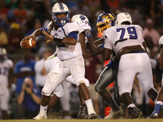 Godby's Rasean Mckay throws the ball against Rickards during their game at Cox Stadium on Friday night.