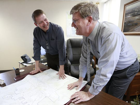 Mayor Chris Meyer, left, mingles with the city administrator Steve Barg Wednesday, April 11, 2018, at his office in Marshfield, Wisc. T'xer Zhon Kha/USA TODAY NETWORK-Wisconsin