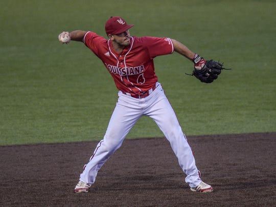 UL shortstop Blake Trahan (4) throws to first base
