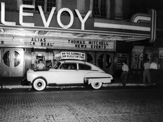 Millville businesses raffled a new Oldsmobile parked in front of the Levoy Theatre in 1949.
