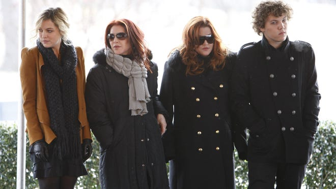 Priscilla Presley, second from left, her daughter, Lisa Marie, second from right, and Lisa Marie's children, Riley Keough, 21, left, and Benjamin Keough, 18, right, take part in a ceremony commemorating Elvis Presley's 75th birthday on Friday, Jan. 8, 2010 in Memphis, Tenn.