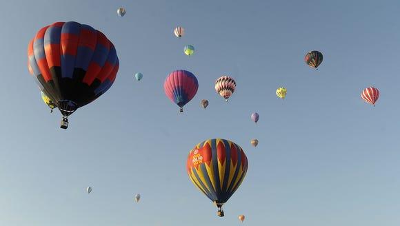 Hot air balloons fill the sky Saturday morning at the