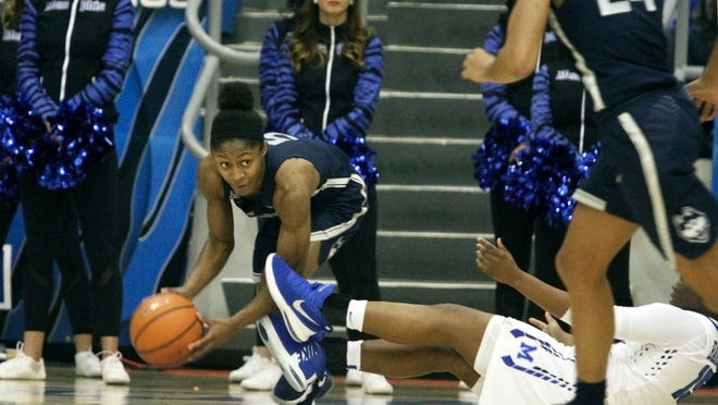 Connecticut guard Crystal Dangerfield (5) grabs a loose ball from Memphis' Taylor Barnes (15) in the second half of Wednesday's game.