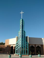 St. Thomas Aquinas Catholic Church is a stately church on the East Side with a 72 stained-glass window in its 48-foot-tall tower.