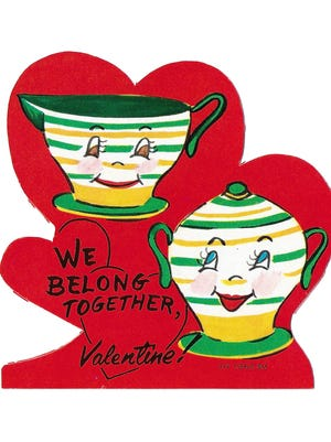 "This 1950s cutout card picturing a cup and saucer and the message ""We belong together"" sold this year for 50 cents."