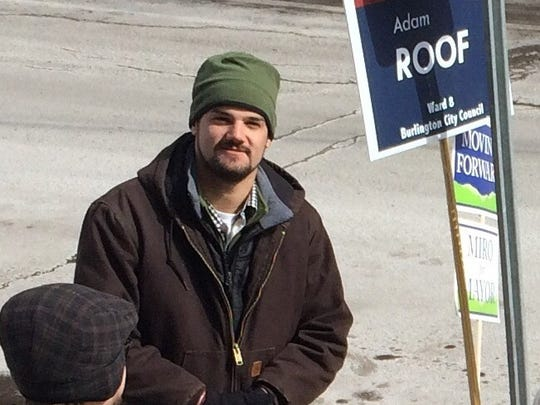 Burlington City Councilor-elect Adam Roof, I-Ward 8, campaigns on Town Meeting Day.