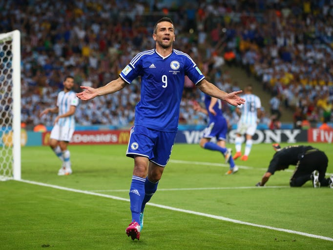 RIO DE JANEIRO, BRAZIL - JUNE 15:  Vedad Ibisevic of Bosnia and Herzegovina celebrates scoring his team's first goal during the 2014 FIFA World Cup Brazil Group F match between Argentina and Bosnia-Herzegovina at Maracana on June 15, 2014 in Rio de Janeiro, Brazil.  (Photo by Julian Finney/Getty Images)