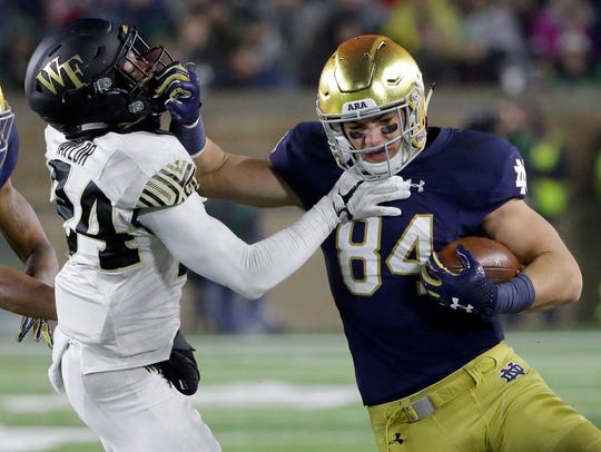 Notre Dame tight end Cole Kmet, right, runs with the