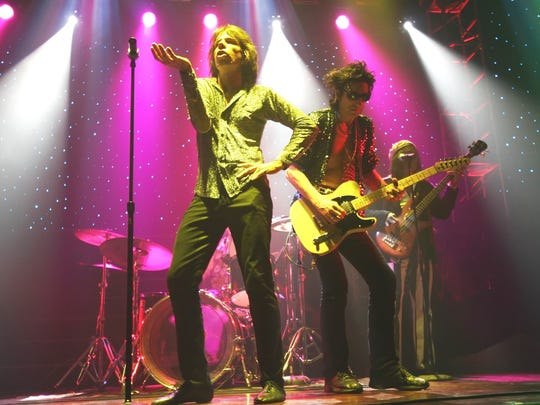 Chris Legrand, left, struts as Mick Jagger, Trey Garitty performs as Keith Richards and John Wade portrays Bill Wyman in the Rolling Stones tribute act Satisfaction.