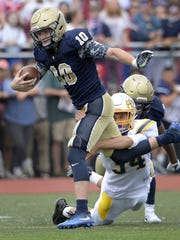 Brighton's Shea McDonald, left, is tackled by Irondequoit's