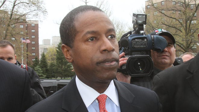 New York state Sen. Malcolm Smith  arrives at the federal courthouse in White Plains for his arraignment in a federal bribery case April 23, 2013.
