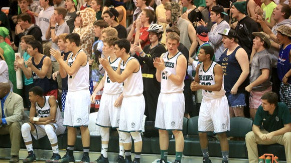 Christ School's bench reacts during a big moment in Thursday's game.