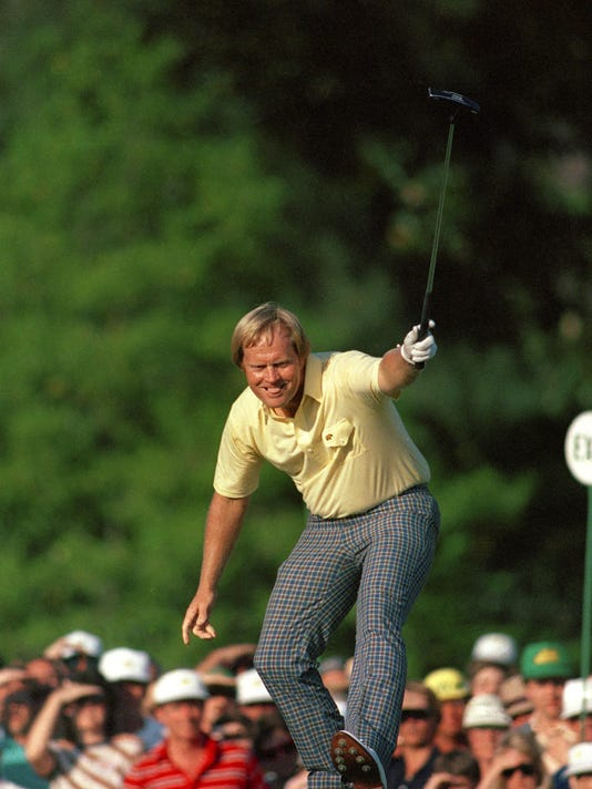 """FILE - In this April 13, 1986, file photo, Jack Nicklaus watches his putt drop for a birdie on the 17th hole during the Masters golf tournament at Augusta National in Augusta, Ga. If the Masters doesn't really begin until the back nine Sunday, the final place to build, or lose, momentum is the 460-yard ninth hole known as """"Carolina Cherry."""" It's where Jack Nicklaus made birdie to begin his charge in 1986.(AP Photo/Phil Sandlin)"""