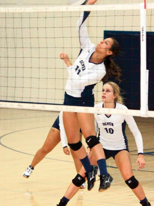 Danny Udero/Sun-News   Silver's Jazmyn Miranda ended game four against Deming with a kill to help seal the match, 3-1.