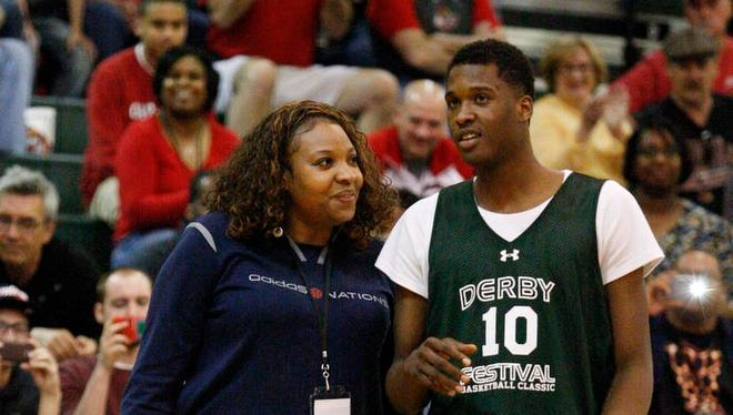 U of L signee Jaylen Johnson, #10, right, confers with his mother Janetta Johnson as he asks for her assistance during the Derby Festival Basketball Classic dunk contest at the Floyd Central High School.  Johnson was one of three dunk finalists who will compete during the Classic. Apr. 17, 2014