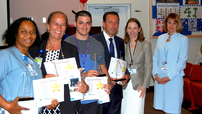 White Plains Hospital employees walked the equivalent of a third of the way to the moon last summer as part of its Ex-STEP-tional Walking Challenge. Hospital President and CEO Susan Fox and Chief Human Resources Officer Diane Woolley presented employees with awards for their efforts at the 2015 challenge.