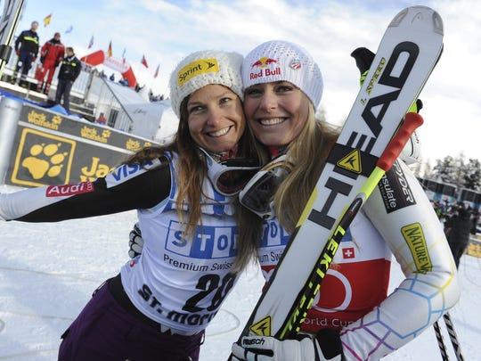 In this Dec. 8, 2012, file photo, Lindsey Vonn, right,  celebrates with third-placed Julia Mancuso after winning an alpine ski, women's World Cup super-G, in St. Moritz, Switzerland.
